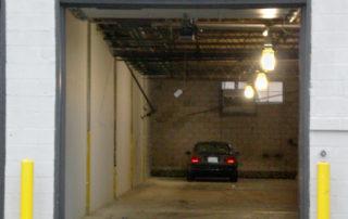 Overhead warehouse door with car inside
