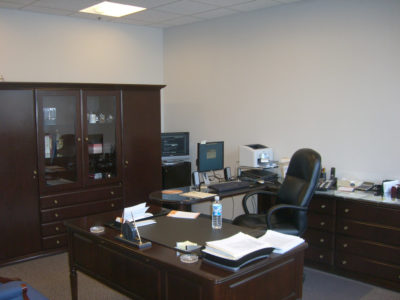 Executive office with desks, cabinets and drawers