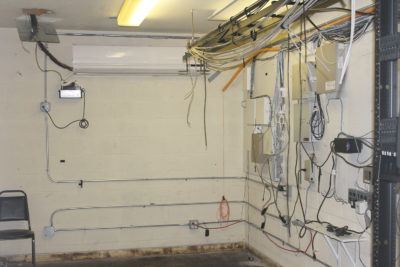 Empty server room with electrical and communications wires/